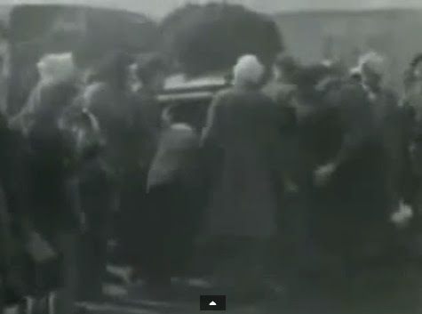 "Such                             people are NOT Jewish detainees but GERMAN                             soldiers in gray coats and with head                             injuries with white head bandages. Here they                             are standing allegedly around a ""water                             lorry"". (2min. 9sec.)"