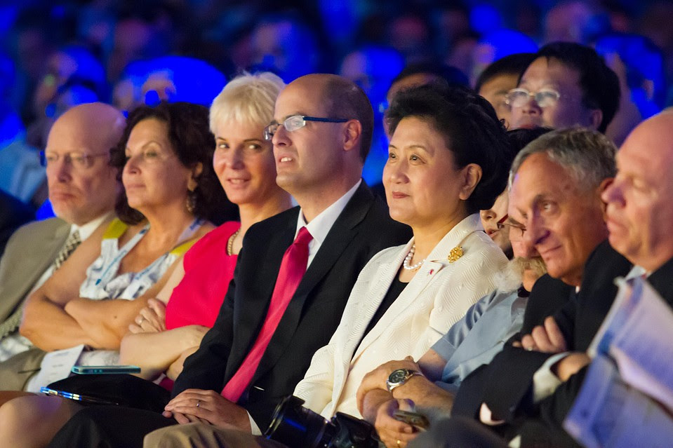 Liu Yandong, vice premier of the People's Republic of China, in a white jacket, and  Avi Hasson, Israel's chief scientist of the Ministry of Economy, in a red tie, attend  a three-day tech conference held in May in Tel Aviv.