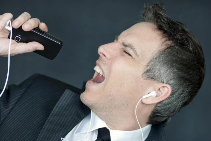 singing into phone - Surprising Ways To Charge Your Phone Without Electricity