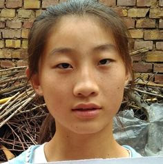 Ou Miaomiao's father has been ill this year and the family has had a hard time with bills. She is a high school student.