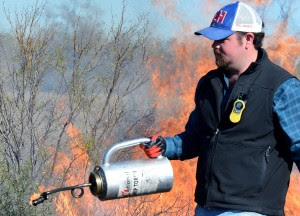Houston Dobbins, Texas A&M AgriLife Extension Service agent in Val Verde County, mans a drip torch during a recent prescribed-fire training for AgriLife Extension agents. (Texas A&M AgriLife Communications photo by Steve Byrns)