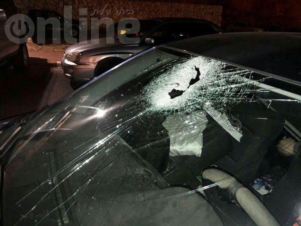 Windshield smashed in a stoning attack by Arab terrorists.