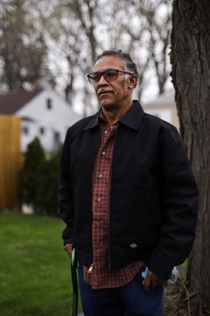 Lester Earley is pictured outside his home in Detroit on April 8, 2021. Earley, 65, has been trying to start a private security guard agency, but his felony convictions are holding him back from the licenses he needs to start his business. New Michigan laws will take effect on Sunday that will expand eligibility for criminal record expungement. Earley hopes that he can finally get his record cleared.