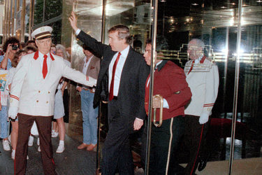 Donald J. Trump leaving Trump Tower in Manhattan in June 1990. Mr. Trump had amassed $3.4 billion in debt by that year.