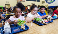 Students eating school lunches
