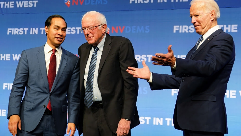 n this file photo, Democratic US presidential candidates Julian Castro, Bernie Sanders and Joe Biden are pictured on stage at a First in the West Event at the Bellagio Hotel in Las Vegas, Nevada, Nov. 17, 2019.