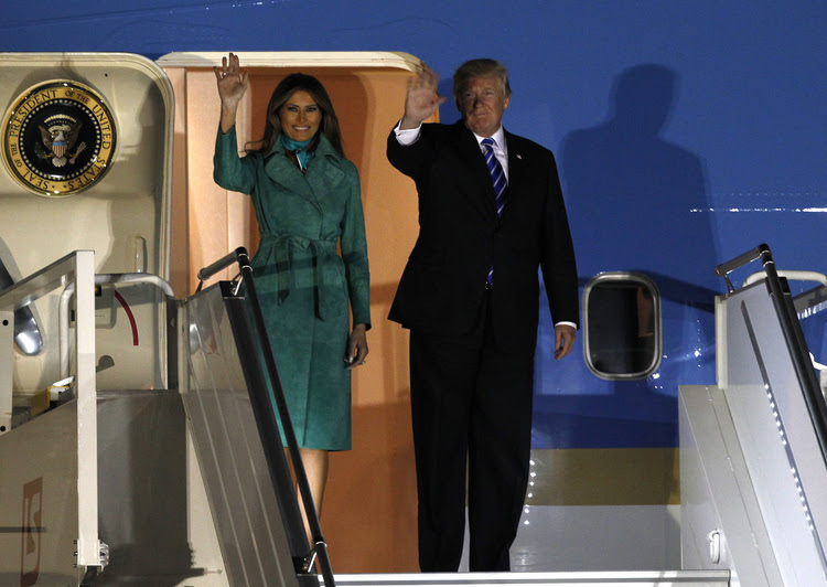 Donald and Melania Trump wave from the Air Force One upon their arrival to Warsaw, Poland. (/Czarek Sokolowski/AP)</p>