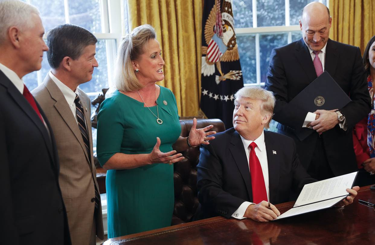 President Donald Trump looks over to Rep. Ann Wagner (R. Mo.), as she speaks before the president signs an executive order in the Oval Office in February.