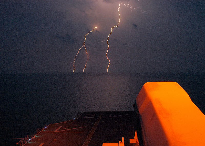 File:US Navy 040711-N-6616W-001 A Rolling Airframe Missile launcher overlooks the flight deck from the amphibious assault ship USS Saipan's 08 level as lightning announces an approaching storm during flight quarters.jpg