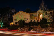"Tammy and Paul York are using the Star Shower laser Christmas lights for a second year, at their home in Colorado Springs. ""We're getting older, so we didn't have to worry about injuring ourselves,"" she said."