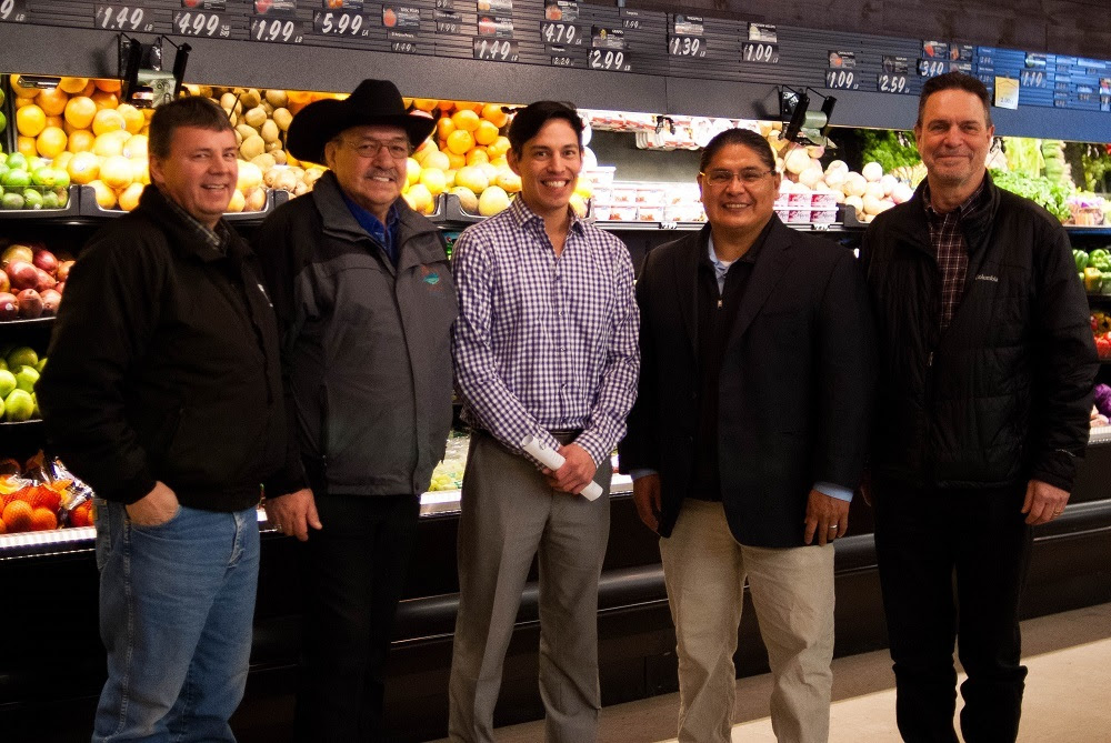 Photo of men in a grocery store.