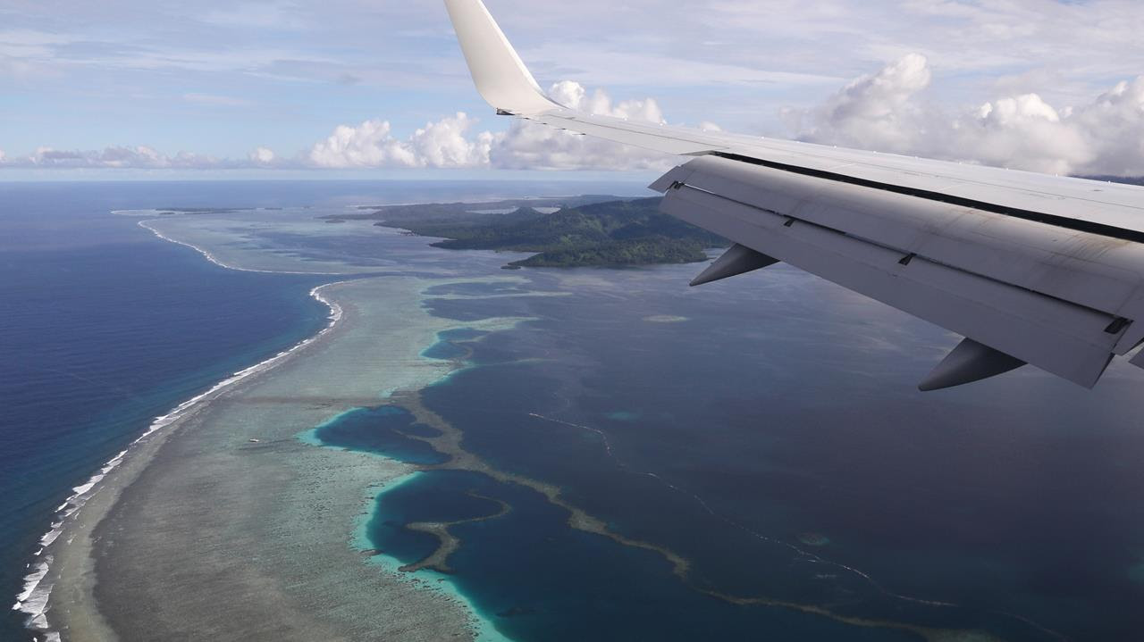 US Secretary of State Mike Pompeo's plane makes its landing approach on Pohnpei International Airport in Kolonia, Federated States of Micronesia, Aug. 5, 2019.