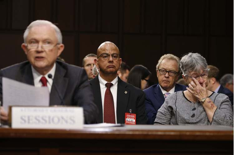 Mary Blackshear Sessions, right, wipes a tear as her husband testifies yesterday. (Jonathan Ernst/Reuters)</p>