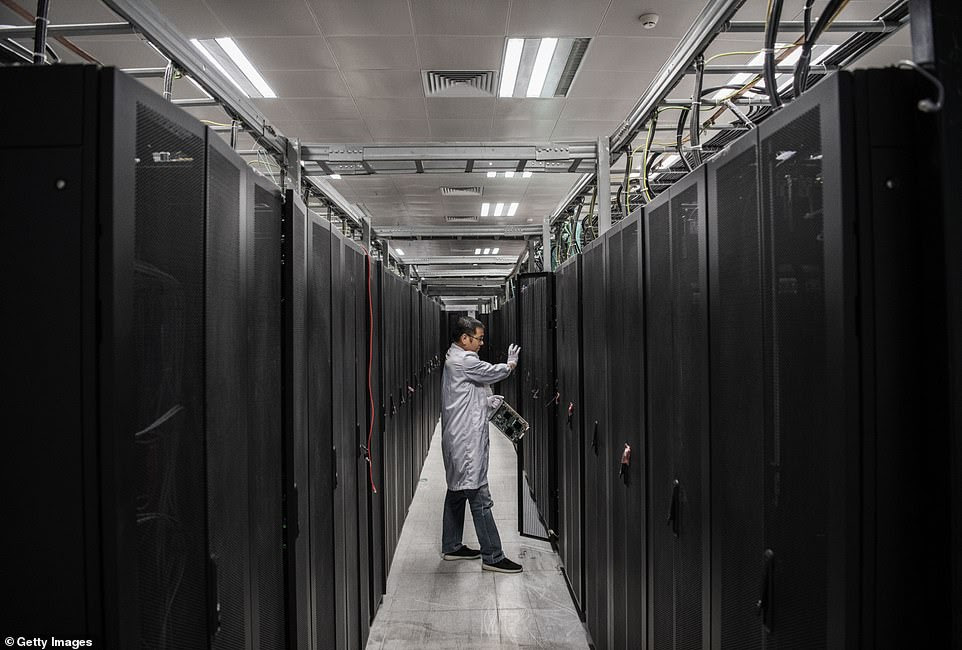 A Huawei engineer opens a door of a server unit at the Cyber Security Lab of the company's production campus. The Ox Horn Campus is currently dedicated to the research and development of Huawei products, including phones and 5G technology