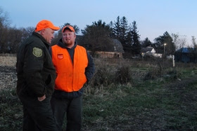DNR officer and hunter