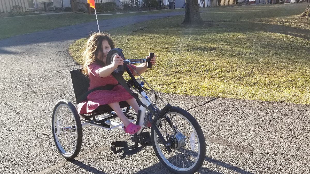 Ari on her new hand cycle