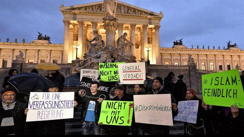 Protesters gathered outside the parliament in Vienna to protest against the new law [EPA]