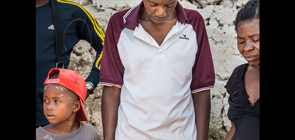 Residents pray on Wednesday, Oct. 12, 2016, at a home in Duchity, Haiti. LCMS Communications/Erik M. Lunsford