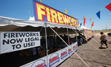Customers walk into a  Red Hot Fireworks tent in Phoenix.