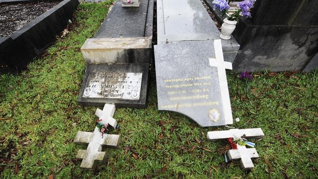 Vandals pushed over many headstones among the 76 desecrated graves at Rookwood Cemetery.