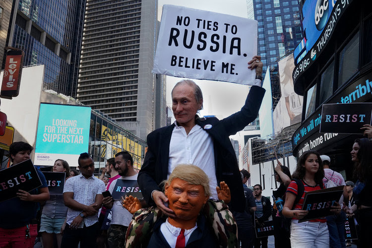 Demonstrators dressed as Vladimir Putin and Donald Trump attend a protest in Times Square. (Carlo Allegri/Reuters)