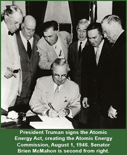 President Truman signs the Atomic Energy Act, creating the Atomic Energy Commission, August 1, 1946. Senator Brien McMahon is second from right.