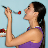 Woman Eating an Strawberries