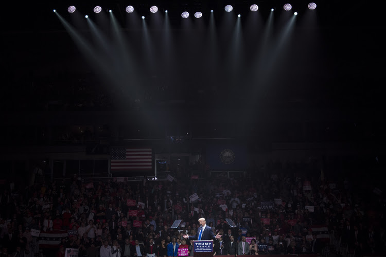 There was a laser show at SNHU Arena as Trump came on stage in Manchester last night. (Jabin Botsford/The Washington Post)</p>