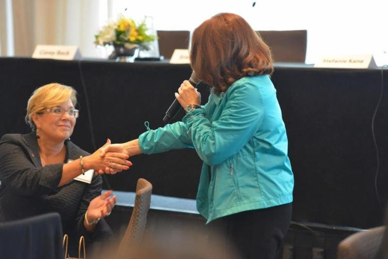 Lisa Tepper helps Raleigh Mayer demonstrate a dynamic handshake