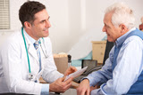Health care provider talking to patient