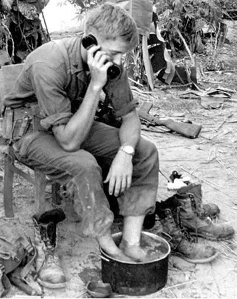 vintage wwii soldier soaking feet in bucket