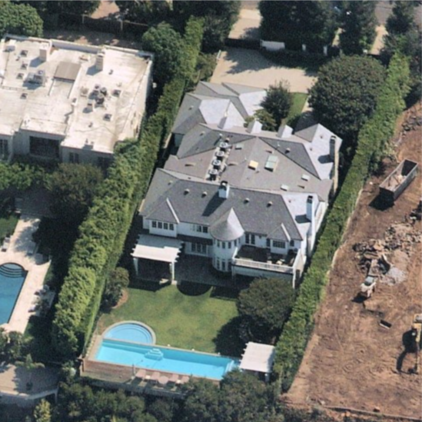 Aerial view of homes with swimming pool