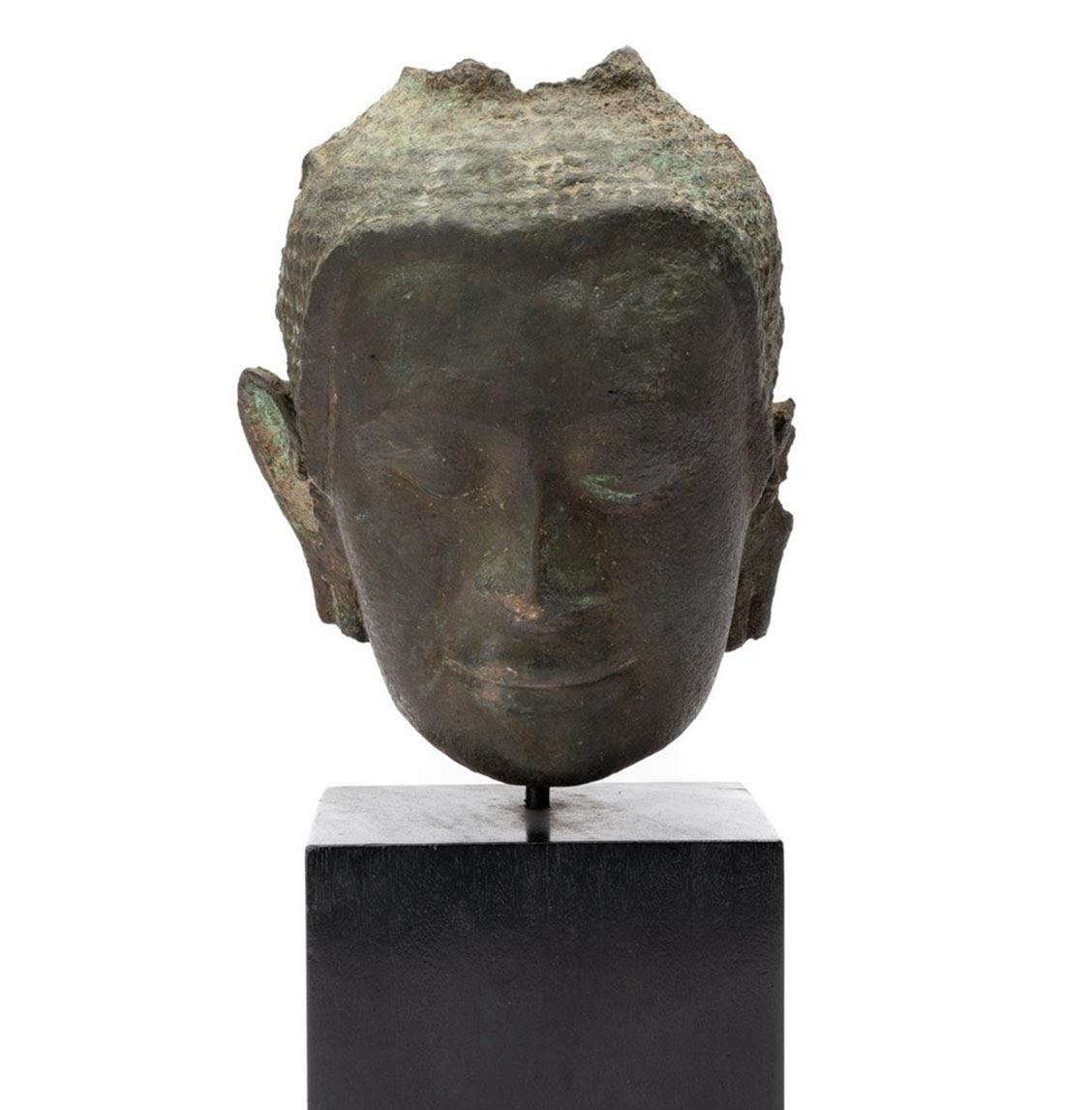 Lot 49. Thai Head of Buddha 12-13th century, bronze