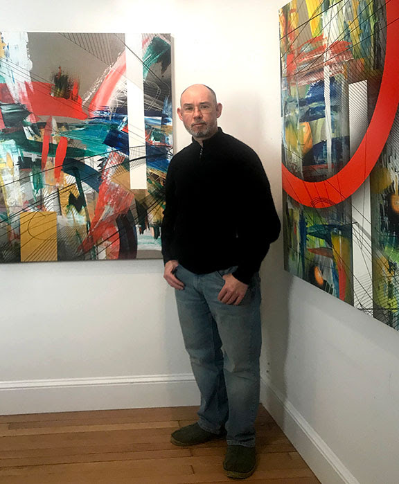 Artist Colin Goldberg with recent paintings Invictus, 2020 (left) and Dr. No, 2020 (right). Each work is 48 x36 inches, acrylic and archival inkjet on linen. Photo: Aya Goldberg.
