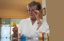 Patient looking at a pill bottle