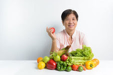 Asian woman with fruits and vegetables