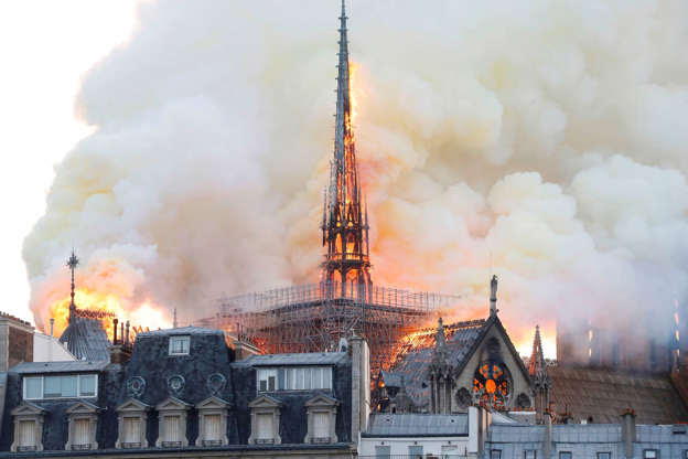 Slide 28 of 31: Smoke and flames rise during a fire at the landmark Notre-Dame Cathedral in central Paris on April 15, 2019, potentially involving renovation works being carried out at the site, the fire service said. (Photo by FRANCOIS GUILLOT / AFP)        (Photo credit should read FRANCOIS GUILLOT/AFP/Getty Images)