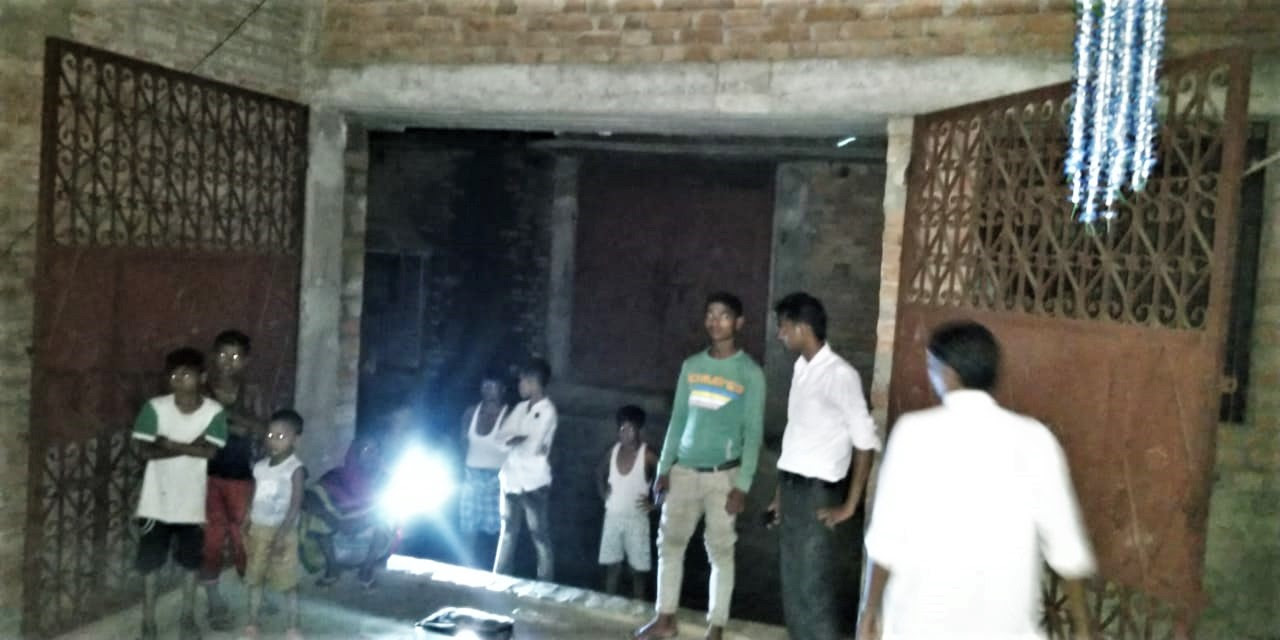 Some youths at entrance of house where film was shown in Jamalpur, Bihar state, India. (Morning Star News)