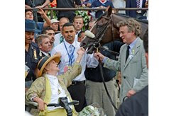 Phyllis and Jamie Wyeth celebrate in the Belmont Stakes winner's circle with Union Rags