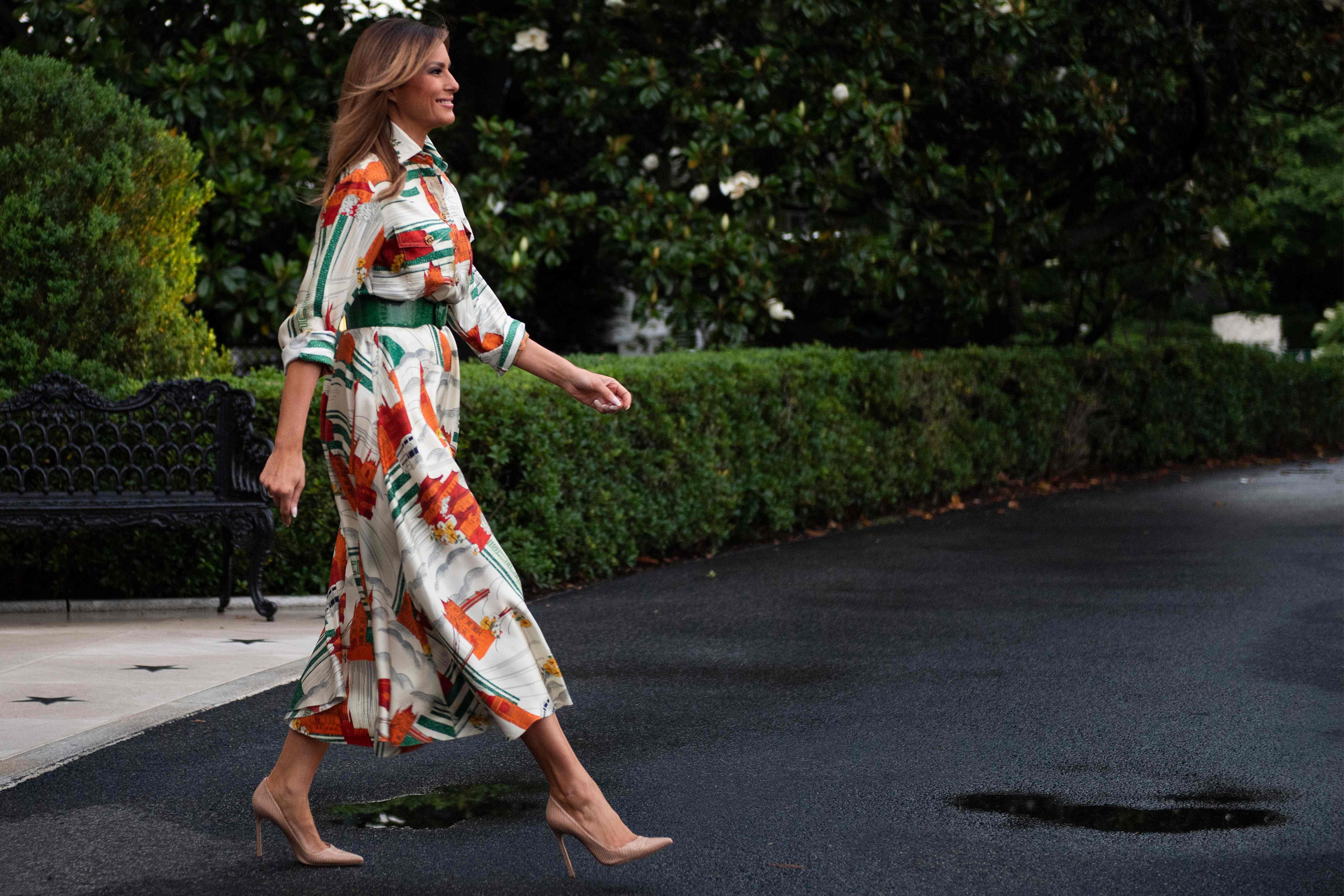 Melania Trump wore a Gucci dress printed with London landmarks on her way to the Capital
