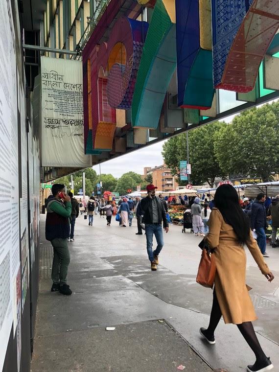 Bangladesh 50 exhibition with Whitechapel Market in background
