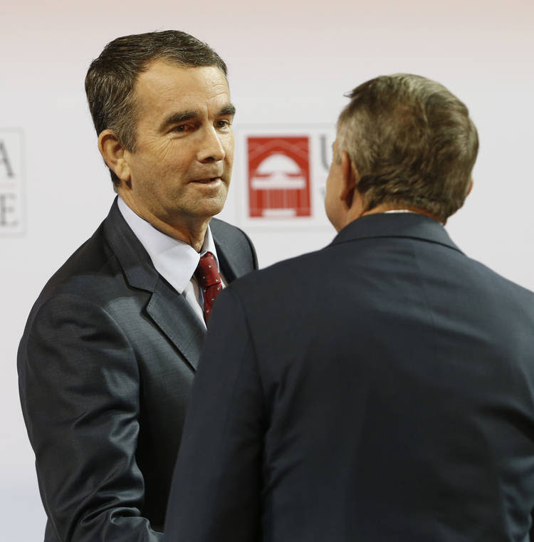 Northam shakes hands with Gillespie before the debate. (Steve Helber/Associated Press)