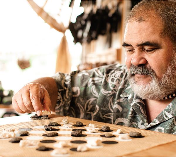 John Kaohelaulii, a cultural practitioner on Kauaʻi, has been playing the Hawaiian strategy game kōnane since he was eight years old. | Photo: Christian Kahahawai