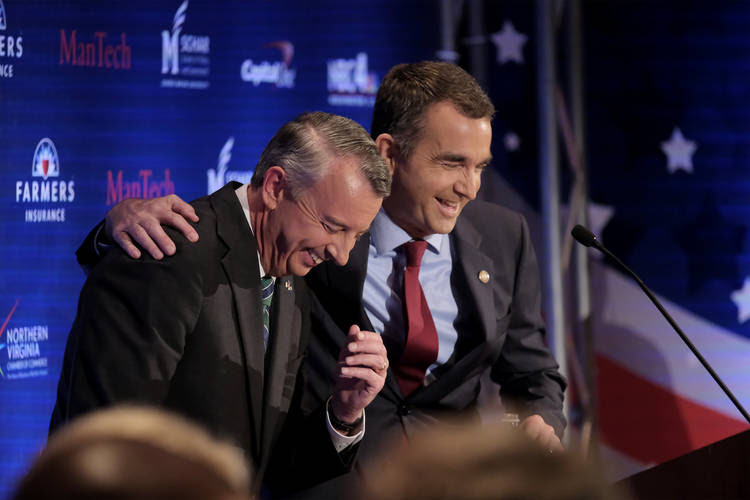 Ed Gillespie and Ralph Northam joke around during a commercial break during a debate. (Bonnie Jo Mount/The Washington Post)