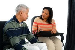 health worker talking with an elderly man