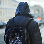 student in coat from                                           behind