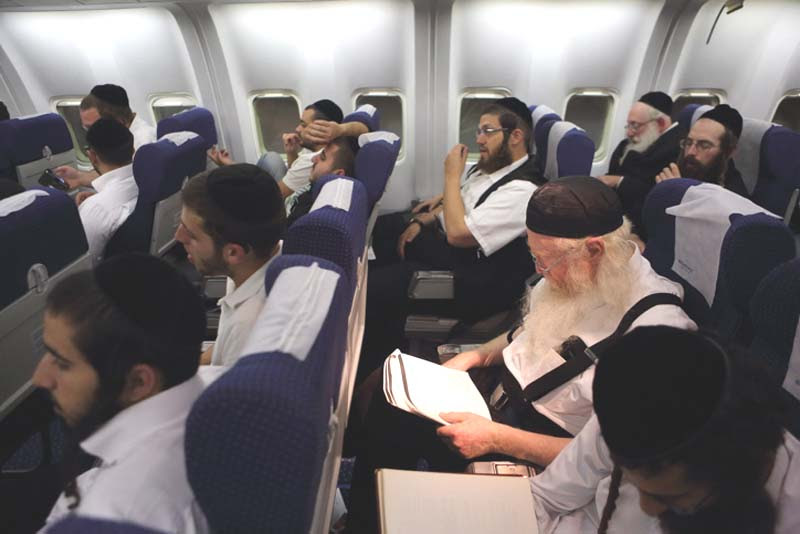 Haredi men in flight