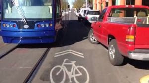 Streetcar, bikes and parked cars