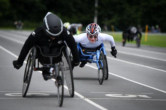 Wheelchair athletes on a track racing