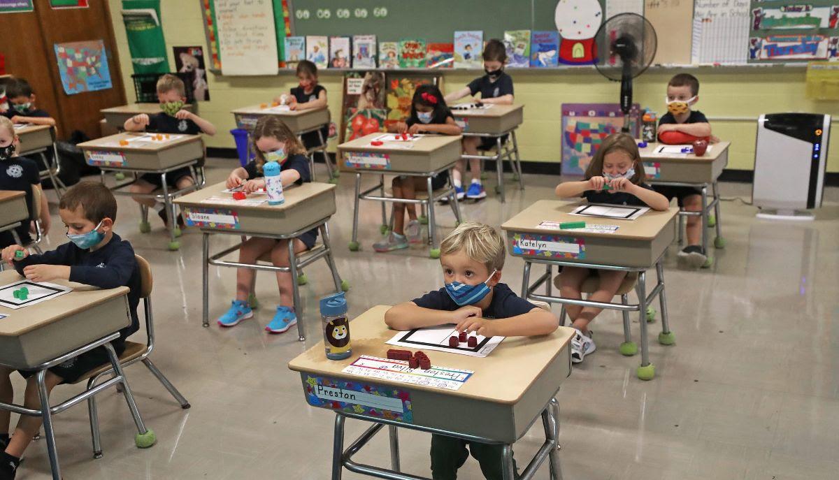 masked childrenin class